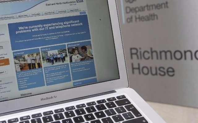 Illustrative: This photograph, posed as an illustration on May 12, 2017, shows the website of the NHS: East and North Hertfordshire notifying users of a problem in its network, taken outside the Department of Health in London. (Daniel Leal-Olivas/AFP)
