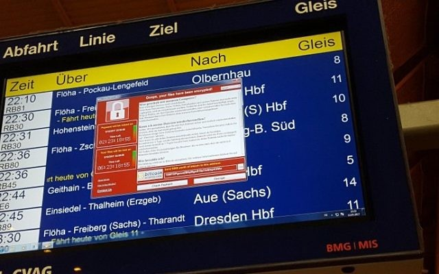 A window announcing the encryption of data including a requirement to pay appears on an electronic timetable display at the railway station in Chemnitz, eastern Germany, on May 12, 2017. (AFP PHOTO / dpa / P. GOETZELT)