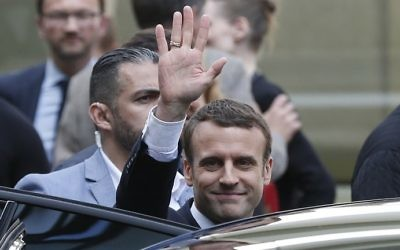French President-elect Emmanuel Macron (C) gestures as he leaves an event for La Republique En Marche party candidates at the entrance of the Quai Branly museum on May 13, 2017, in Paris. (AFP Photo/Charly Triballeau)