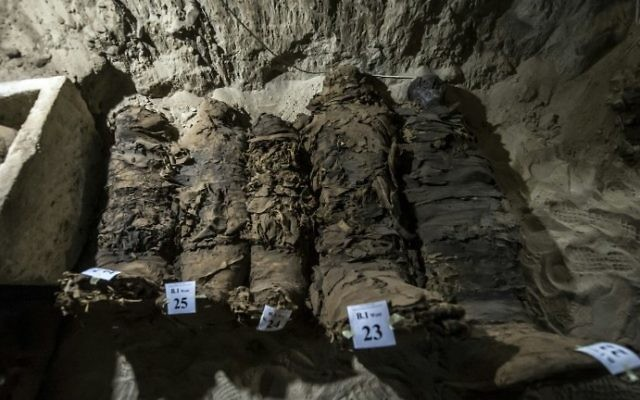 A picture taken on May 13, 2017, shows mummies lying in catacombs following their discovery in the Touna el-Gabal district of the Minya province, in central Egypt. (AFP PHOTO / KHALED DESOUKI)