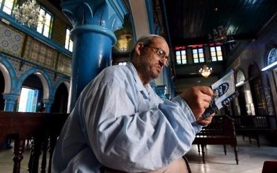 Tunisian Rabbi Daoud reads from a prayer book at the Ghriba Synagogue on the Tunisian resort island of Djerba on May 14, 2017, during the second day of the annual Jewish pilgrimage to the synagogue thought to be Africa's oldest. (FETHI BELAID / AFP)