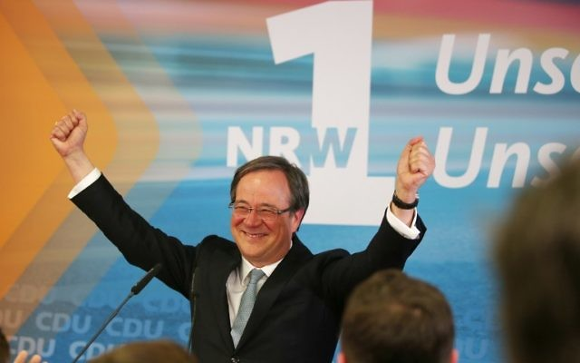 Armin Laschet, top candidate of the conservative Christian Democratic Union (CDU) celebrates during an election party on May 14, 2017 in Duesseldorf, western Germany, after North Rhine-Westphalia state elections. (AFP PHOTO / dpa / Oliver Berg)