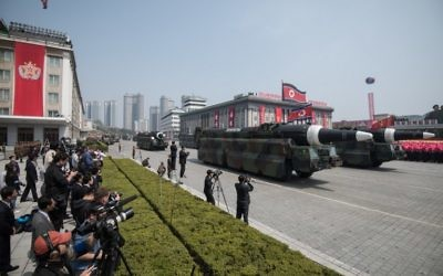 This picture taken on April 15, 2017 shows an unidentified rocket, reported to be a Hwasong-type missile similar to the one used in a May 14, 2017 test launch, at a military parade in Pyongyang. (AFP PHOTO / Ed JONES)