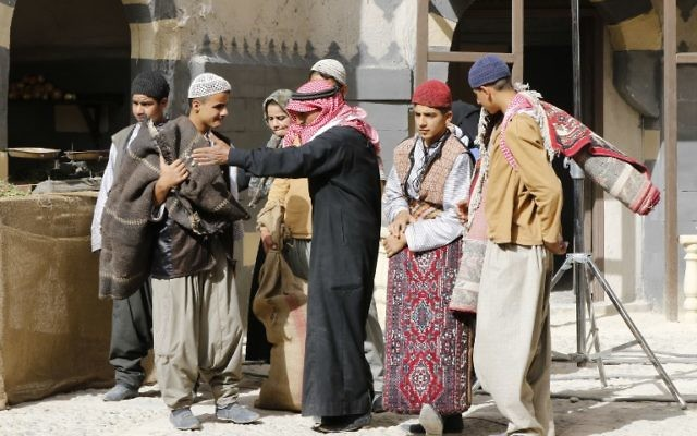 Syrian actors are seen on the filming set of television series 'Tawq al-Banat' in the village of Yaafur, some 20kilometres (12 miles) west of Damascus on May 14, 2017. (AFP/Louai Beshara)