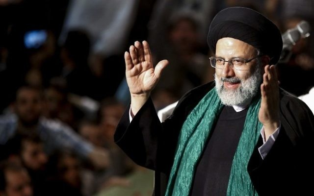 Iranian presidential candidate Ebrahim Raisi greets his supporters during a campaign rally at Imam Khomeini Mosque in the capital Tehran on May 16, 2017. (AFP Photo/Atta Kenare)