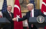 US President Donald Trump shakes hands with Turkish President Recep Tayyip Erdogan after speaking to the press in the Roosevelt Room of the White House on May 16, 2017. (AFP Photo/Saul Loeb)