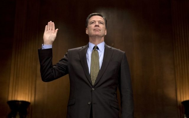 Then-FBI Director James Comey sworn in prior to testifying before the Senate Judiciary Committee on Capitol Hill in Washington, DC, May 3, 2017. (AFP/JIM WATSON)
