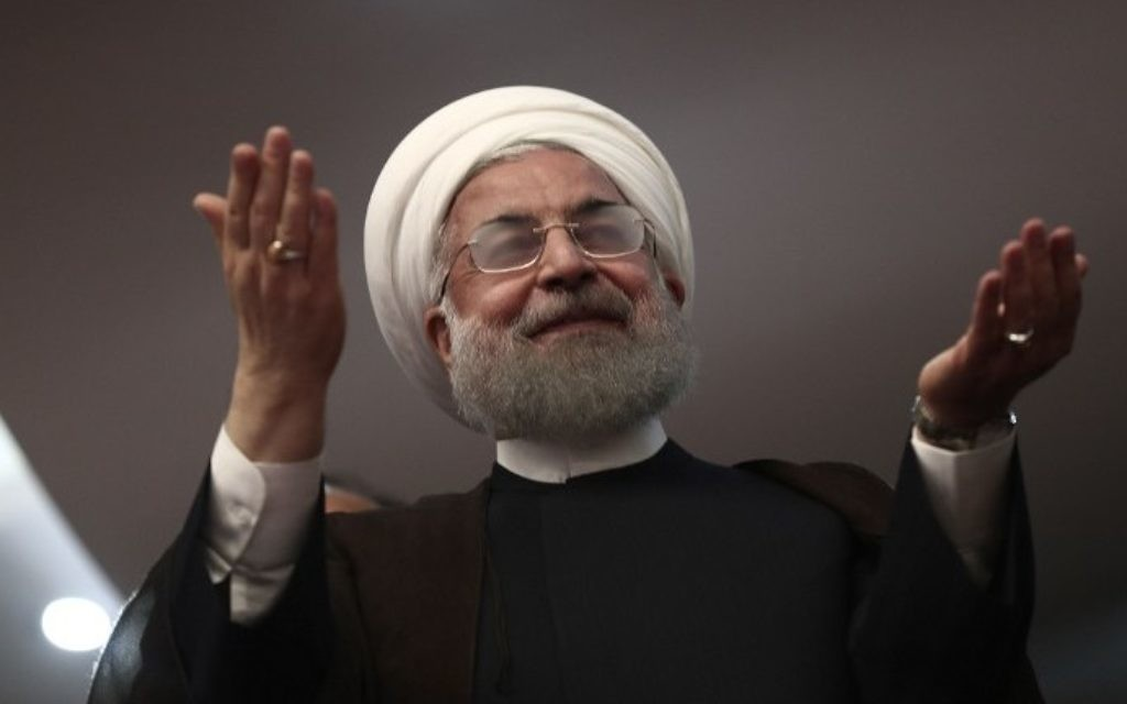 Iranian President and candidate in the upcoming presidential elections Hassan Rouhani gestures during a campaign rally in the northwestern city of Ardabil on May 17, 2017. (AFP Photo/Behrouz Mehri)