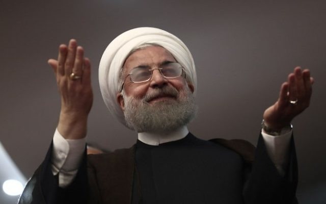 Iranian President Hassan Rouhani gestures during a campaign rally in the northwestern city of Ardabil on May 17, 2017. (AFP PHOTO / Behrouz MEHRI)
