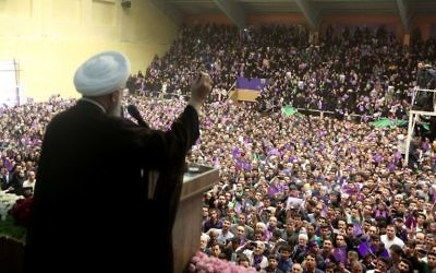 Iranian president and candidate in the upcoming presidential elections Hassan Rouhani speaks during a campaign rally in the northwestern city of Ardabil on May 17, 2017. (AFP Photo/Behrouz Mehri)