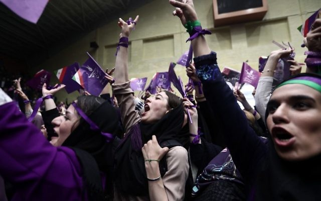 Supporters of Iranian President and candidate in the upcoming presidential elections, Hassan Rouhani, attend a campaign rally in the northwestern city of Ardabil on May 17, 2017. (AFP PHOTO / Behrouz MEHRI)