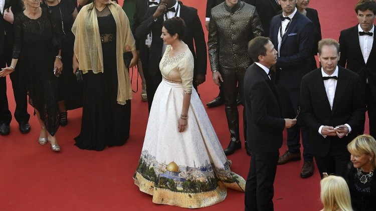 Culture Minister Miri Regev wearing a dress featuring the old city of Jerusalem in Cannes on May 17, 2017 (AFP Photo/Antonin Thuillier)