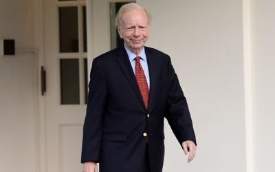 This file photo taken on May 17, 2017, shows US Senator from Connecticut Joe Lieberman leaving the West Wing of the White House after meeting with US President Donald Trump. (AFP Photo/Olivier Douliery)