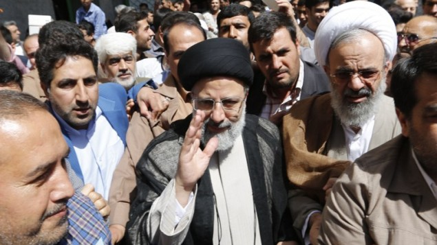 Iranian presidential candidate Ebrahim Raisi arrives to cast his ballot for the presidential elections at a polling station in southern Tehran on May 19, 2017. (Atta Kenare/AFP)