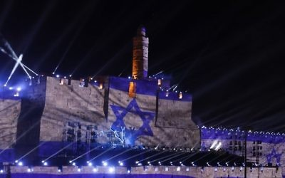 An audio slideshow is projected on the ancient walls of Jerusalem's Old City on May 20, 2017, on the beginning of the week marking the 50th anniversary of the 1967 Israeli-Arab War. ( AFP PHOTO / GALI TIBBON)