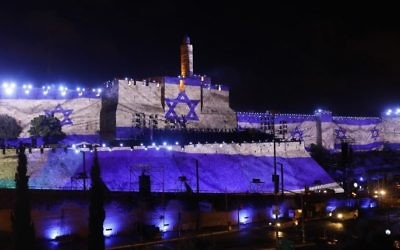 An audio slideshow is projected on the ancient walls of Jerusalem's Old City on May 20, 2017, on the beginning of the week marking the 50th anniversary of the 1967 Six Day War. (AFP Photo/Gali Tibbon)