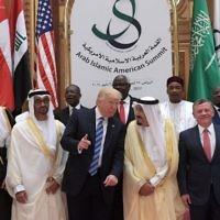 US President Donald Trump, Saudi Arabia's King Salman bin Abdulaziz al-Saud, Jordan's King Abdullah II, Egyptian President Abdel Fattah al-Sissi and other officials pose for a group photo during the Arabic Islamic American Summit at the King Abdulaziz Conference Center in Riyadh on May 21, 2017. (AFP/ MANDEL NGAN)