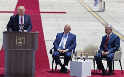 US President Donald Trump speaks as Israeli President Reuven Rivlin and Israeli Prime Minister Benjamin Netanyahu (R) listen upon Trump's arrival at Ben Gurion International Airport in Tel Aviv on May 22, 2017, as part of his first trip overseas. (AFP PHOTO / Jack GUEZ)