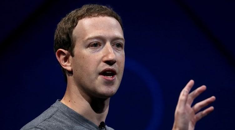 Zuckerberg posts photo of himself and wife baking hamantashen | The