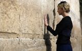 Ivanka Trump, the daughter of US President Donald Trump, prays at the Western Wall, the holiest site where Jews can pray, in Jerusalem's Old City on May 22, 2017. (Heidi Levine / POOL / AFP)