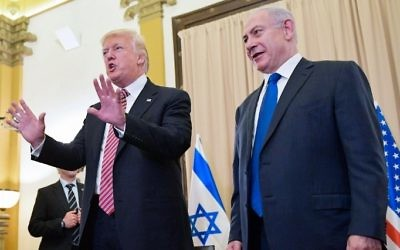 US President Donald Trump, left, reacts to a reporter's question ahead of a meeting with Prime Minister Benjamin Benjamin Netanyahu, right, at the King David Hotel in Jerusalem on May 22, 2017. (AFP/MANDEL NGAN)