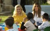 US First Lady Melania Trump (R) and Sara Netanyahu talk with children during a visit to the Hadassah hospital in Jerusalem on May 22, 2017. (AFP PHOTO / POOL / Sebastian Scheiner)