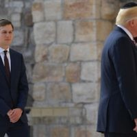 White House senior adviser Jared Kushner, left. watches as US President Donald Trump, his father-in-law, visits the Western Wall in Jerusalem's Old City on May 22, 2017. (AFP Photo/Mandel Ngan)