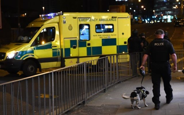 Emergency response vehicles arrive at the scene of a  terrorist attack during a pop concert by US star Ariana Grande in Manchester, northwest England on May 23, 2017. (AFP PHOTO / PAUL ELLIS)