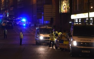 Police stand guard at the scene of a suspected suicide bombing in which at least 22 people were killed during a concert by US pop star Ariana Grande in Manchester, England, on May 23, 2017. (AFP Photo/Paul Ellis)