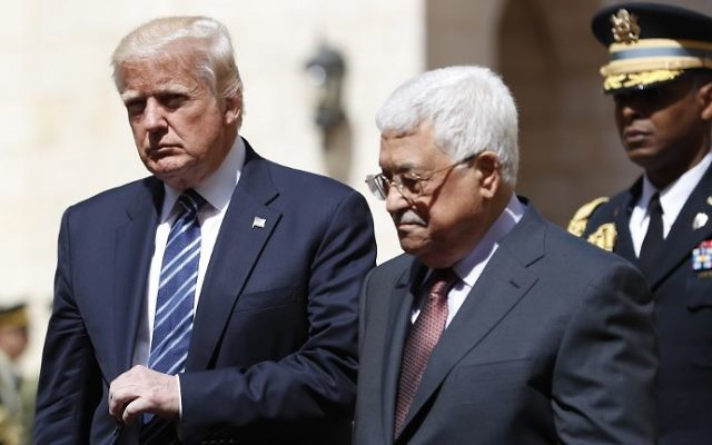 US President Donald Trump (L) is welcomed by Palestinian Authority President Mahmoud Abbas at the presidential palace in the West Bank city of Bethlehem on May 23, 2017. (Thomas Coex/AFP)