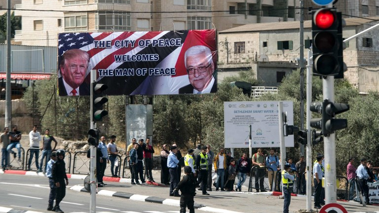 A billboard welcoming US President Donald Trump is seen in Bethlehem as he arrives in the West Bank city to meet with Palestinian Authority President Mahmoud Abbas on May 23, 2017. (MANDEL NGAN / AFP)