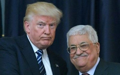 US President Donald Trump, left, and Palestinian leader Mahmoud Abbas pose for a photograph during a joint press conference at the presidential palace in the West Bank city of Bethlehem, on May 23, 2017. (AFP/Mandel Ngan)