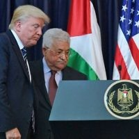 US President Donald Trump (L) and Palestinian leader Mahmoud Abbas leave following a joint press conference at the presidential palace in the West Bank city of Bethlehem on May 23, 2017. (AFP/ MANDEL NGAN)