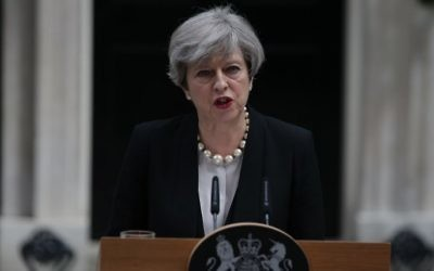 The day after a a deadly suicide bombing in the northern city of Manchester, Britain's Prime Minister Theresa May delivers a statement outside 10 Downing Street in central London after an emergency meeting of the Cobra committee, May 23, 2017. (AFP/Daniel LEAL-OLIVAS)