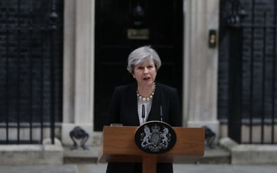 British Prime Minister Theresa May delivers a statement outside 10 Downing Street in London on May 23, 2017. (AFP Photo/Daniel Leal-Olivas)