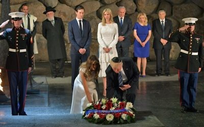 US President Donald Trump (C-R) and First Lady Melania Trump (C-L) lay a wreath during a visit to the Yad Vashem Holocaust Memorial museum on May 23, 2017, in Jerusalem. (MANDEL NGAN / AFP)
