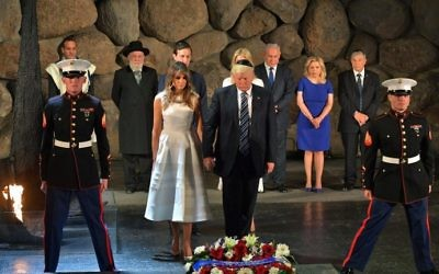 US President Donald Trump (C-R) and First Lady Melania Trump (C-L) lay a wreath during a visit to the Yad Vashem Holocaust Memorial museum, on May 23, 2017, in Jerusalem. (MANDEL NGAN / AFP)
