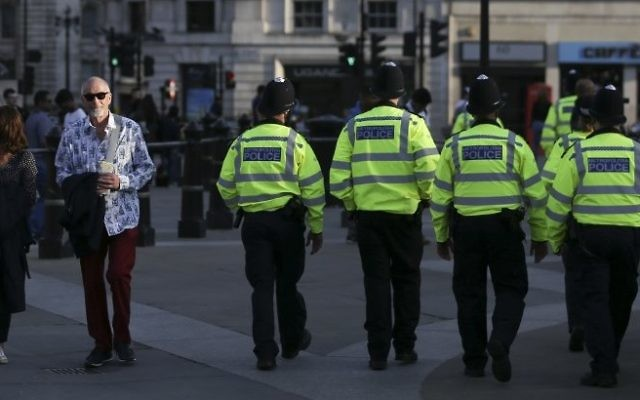 British police patrol through Trafalgar Square in central London on May 23, 2017 a day after a deadly terror attack at the Ariana Grande concert at the Manchester Arena. (AFP / Daniel LEAL-OLIVAS)