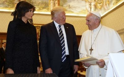 Pope Francis (R) exchanges gifts with US President Donald Trump and US First Lady Melania Trump during a private audience at the Vatican on May 24, 2017. (Evan Vucci/Pool/AFP)