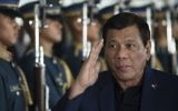 Philippine President Rodrigo Duterte walks past honor guards as he arrives at Manila international airport in Manila on May 24, 2017.  (AFP/Noel Celis)