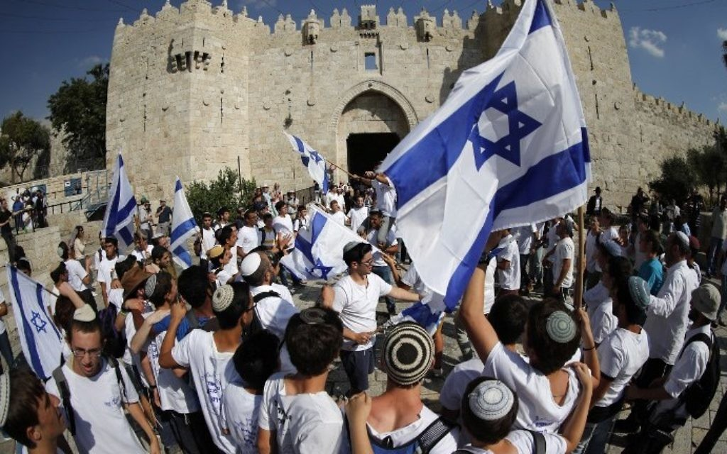 Israelis wave flags as they celebrate Jerusalem Day outside Damascus Gate in Jerusalem's Old City on May 24, 2017. (AFP PHOTO / Thomas COEX)