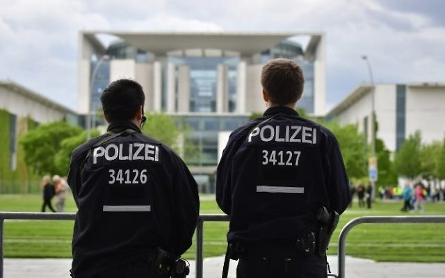 Illustrative: Police officers stand in front of the chancellery in Berlin, on May 24, 2017. (AFP/John MacDougall)