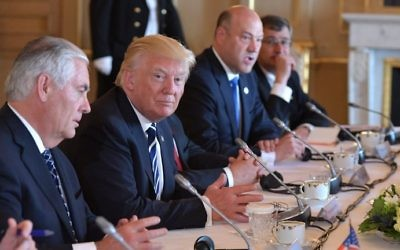 US President Donald Trump (C) takes part in a meeting with US Secretary of State Rex Tillerson (L) and officials on May 24, 2017 in Brussels. (MANDEL NGAN / AFP)