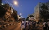 Israelis wearing Israeli flags parade around Jerusalem's Old City on May 24, 2017, to commemorate Jerusalem Day, marking the reunification of the city following the Six Day War of 1967. (AFP PHOTO / Menahem KAHANA)