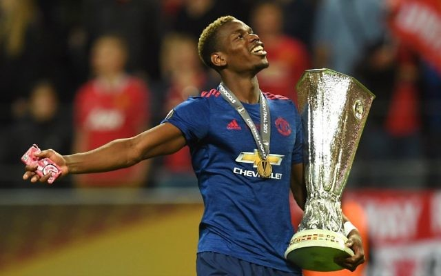 Manchester United's French midfielder Paul Pogba celebrates with the trophy after during the UEFA Europa League final football match Ajax Amsterdam v Manchester United on May 24, 2017 at the Friends Arena in Solna outside Stockholm. (AFP /Paul ELLIS)