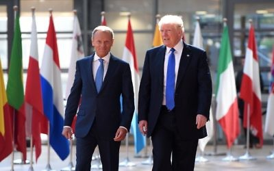 US President Donald Trump (R) speaks to European Council President Donald Tusk (L) upon his arrival at EU headquarters, as part of the NATO meeting, in Brussels, on May 25, 2017. (AFP PHOTO / Emmanuel DUNAND)