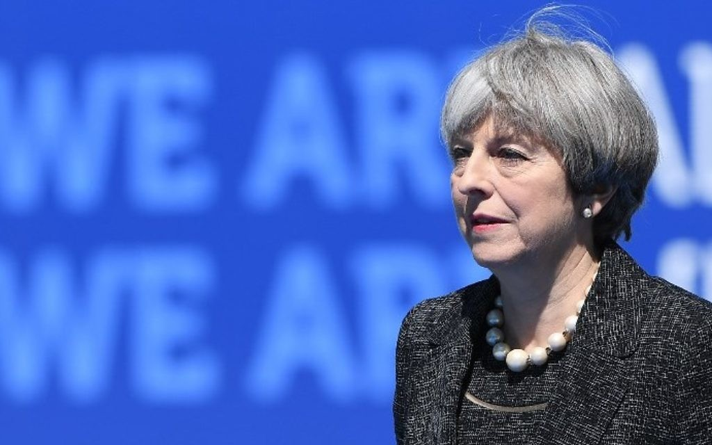 Britain's Prime Minister Theresa May arrives for the NATO (North Atlantic Treaty Organization) summit at the NATO headquarters, in Brussels, on May 25, 2017. (AFP PHOTO / Emmanuel DUNAND)