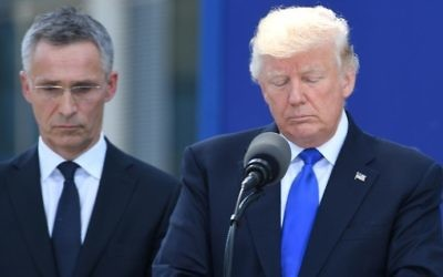 US President Donald Trump, right, stands next to NATO Secretary General Jens Stoltenberg, left, during the unveiling ceremony of the Berlin Wall monument, during the NATO (North Atlantic Treaty Organization) summit at the NATO headquarters, in Brussels, on May 25, 2017. (AFP/ Emmanuel DUNAND)