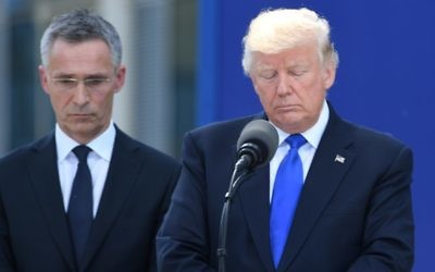 US President Donald Trump (R) stands next to NATO Secretary General Jens Stoltenberg (L) during the unveiling ceremony of the Berlin Wall monument, during the NATO (North Atlantic Treaty Organization) summit at the NATO headquarters, in Brussels, on May 25, 2017.  / AFP PHOTO / Emmanuel DUNAND