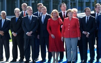 (Front row, LtoR) Portugal's Prime Minister Antonio Costa, Italy's Prime Minister Paolo Gentiloni, King Philippe of Belgium, Poland's President Andrzej Duda, Croatia's President Kolinda Grabar-Kitarovic, German Chancellor Angela Merkel, French President Emmanuel Macron and Belgian Prime Minister Charles Michel attend the unveiling ceremony of the new headquarters of NATO in Evere, Brussels, on May 25, 2017. (AFP Photo/Pool/Christophe Licoppe)